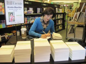 Me signing books in my hometown, Mankato MN. My daughter took the pictures that night...for a price!